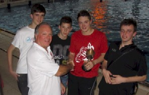 Receiving the trophy from League Secretary Chris Martin