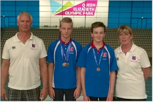 Medallists with Jim & Helen, Top & Youth Squad Coaches