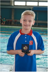 Joseph - with one of his three medals!